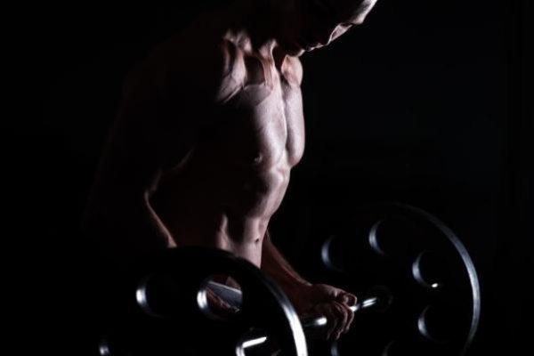 muscular-man-doing-weight-lifting-fitness-center_1163-3550.jpg